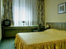 Bedroom in the centrally located Zagreb Comfort Hotel
