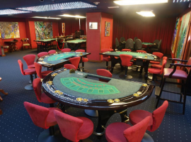 Casino hall with live-game tables