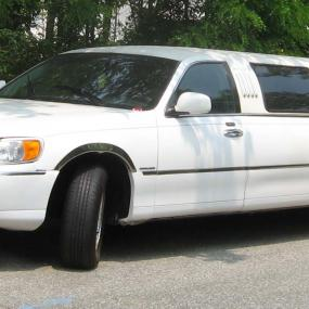 white stretched Lincoln limousine